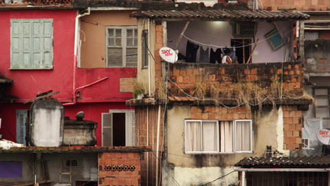 RIO DE JANEIRO, BRAZIL - JUNE 23: Slow-mo of woman doing laundry in a favela Rio Footage