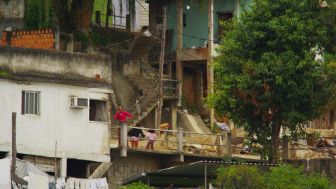 RIO DE JANEIRO, BRAZIL - JUNE 23: Slow-mo of kids playing outside in a favela Ri Footage