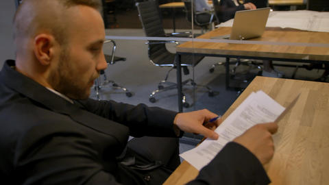 Businessman signing employment contract in office during the meeting Footage