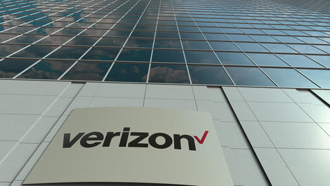 Signage board with Verizon Communications logo. Modern office building facade Live Action