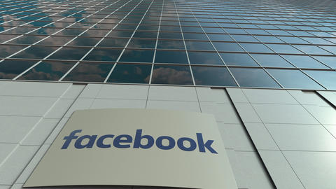 Signage board with Facebook logo. Modern office building facade time lapse Live Action