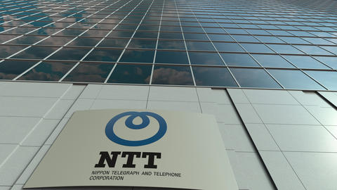 Signage board with Nippon Telegraph and Telephone Corporation NTT logo. Modern Footage