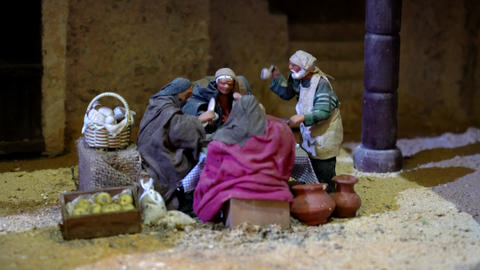 Largest animated nativity scene in South America. Men congregate around table Live Action