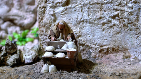 Largest animated nativity scene in South America. Woman makes bread Live Action