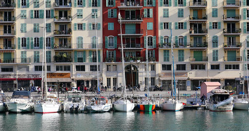 Boats In The Port Of Nice With Colorful Buildings In The Background Live Action