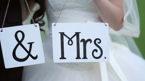 Wedding tablets with the letters Mr and Mrs GIF
