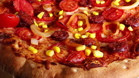 Vegetarian pizza margarita texture closeup on rotating plate. Pizza delivery Footage