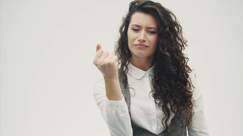 Beautiful young brunette business woman. Shows a fist. Positive human emotions Footage