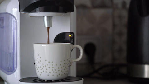 Home capsule coffee machine prepares a cup of fresh coffee Footage