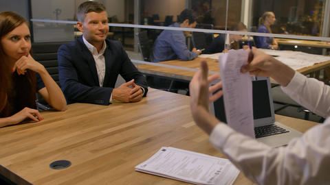 Group of smiling businesspeople meeting in office boardroom Footage