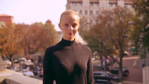 portrait blonde in town GIF