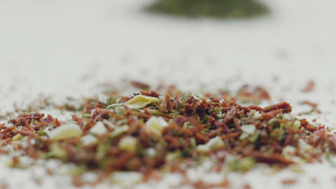 Variety of aromatic spices and herbs on kitchen table Footage