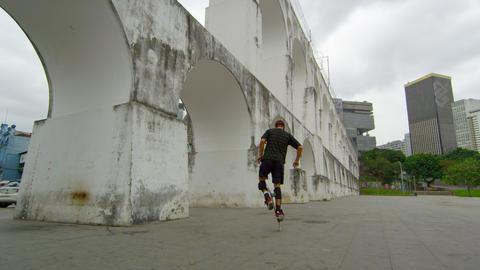 RIO DE JANEIRO-JUNE 23: Skateboarder balances on the wheels of his board on Jun  Footage