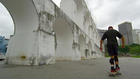 RIO DE JANEIRO, BRAZIL - JUNE 23: Slow dolly shot of skateboarder spins on Jun 2 Footage