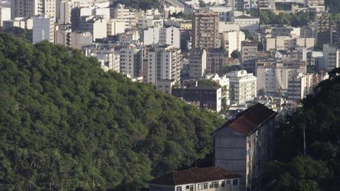 Tilting footage of Rio de Janeiro surrounding the Maracanã stadium Footage