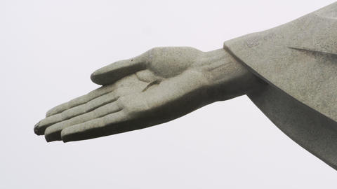 Pan of the sleeve to the right hand of Rio's monumental sculpture of Christ the  Footage