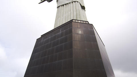 Tilt from the base of Rio's Christ the Redeemer to the sculpture above Footage