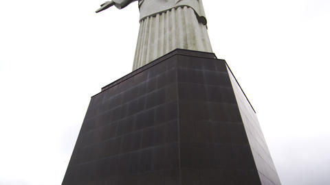 Tilting from the base of Rio's Christ the Redeemer to the sculpture above Footage