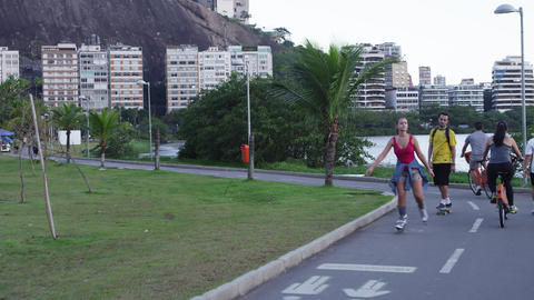 RIO - JUNE 18: People skate, bike, walk path near Lagoa on June 18, 2013 in Rio  Footage