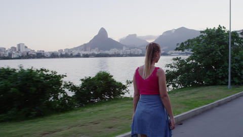 RIO-JUNE 18: Couple rollerblades, skateboards alongside Lagoa on June 18, 2013 i Footage