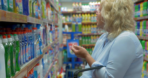 Senior woman buying household detergents in the store Footage