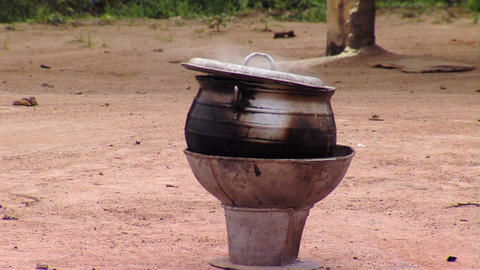 Pot brewing in Africa Live Action