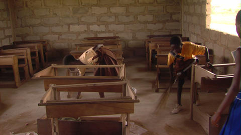 African children cleaning their classroom Footage