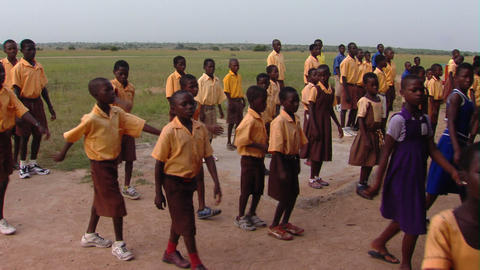 African kids marching into school Footage