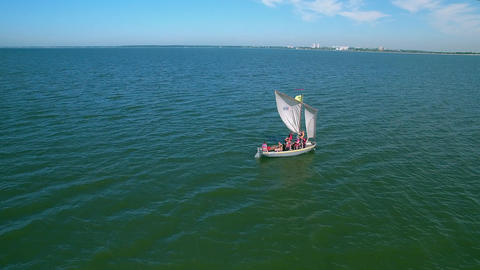 Sailing boat stood in the sea. The motor boat hurries to her aid. Children learn Live Action