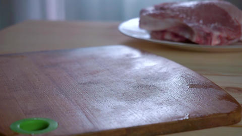 Housewife puts on the table fresh pork steaks. Sprinkle… Stock Video Footage
