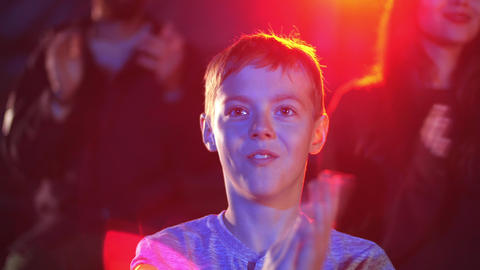 Surprised boy clap hands in circus to the acrobatic and magic show artists Live Action