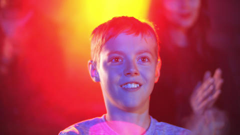 Emotional happy male child clapping in theatre after performance Footage