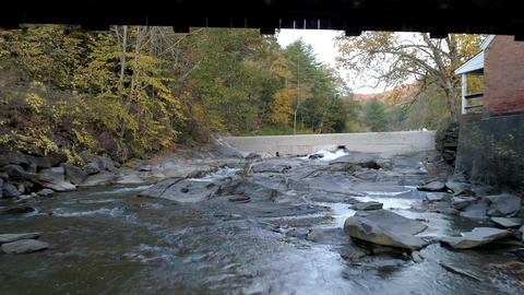 Aerial Drone - Fly Under Weathered Covered Bridge in Fall in Vermont Live Action