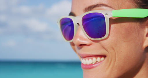 Stylish Happy Woman Wearing Purple Sunglasses At Beach During Summertime Footage