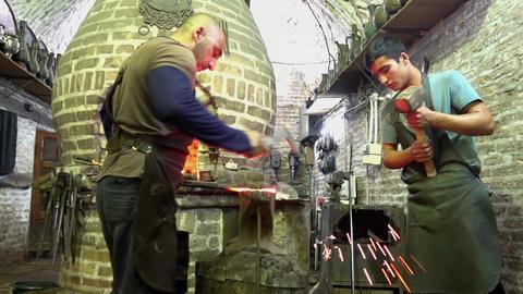 Bukhara, Uzbek - 20170522 - Two blacksmiths scrape and score hot metal Footage