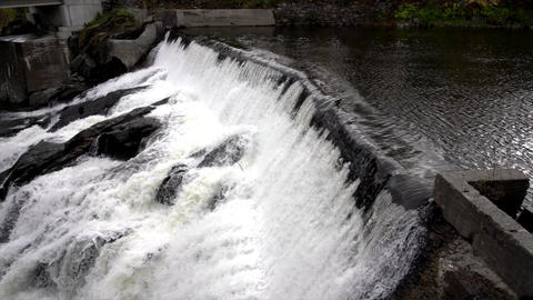 Slow Motion - Water Rushes Over Small Hydro Electric Dam 4K Live Action