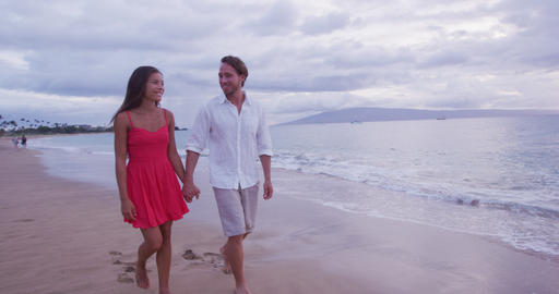 Couple Holding Hands While Walking On Beach Footage