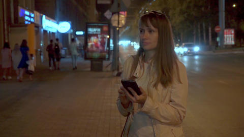 A woman looks at the phone and smiles Footage