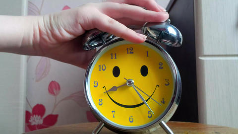 A woman wakes up and turns off her alarm clock Footage