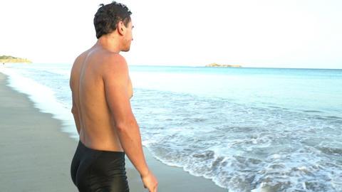 Man raise up hand under the ocean. Winner Live Action