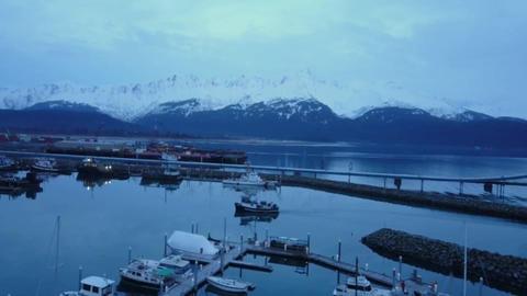 Commercial fishing boat entering harbor in Alaska Live Action