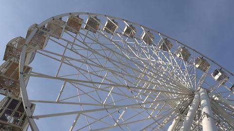 Ferris Wheel Carousel Spinning Blue Sky Background GIF