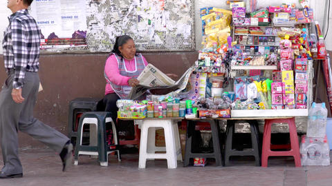 Cuenca, Ecuador - 20180920 - Woman Sits By Her Table of Goods to Sell, Rea Live Action