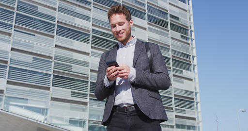 Man sms texting using app on smart phone in city - business man on smartphone Footage
