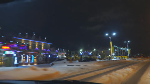 The car drives through the New Year's night city. In the city of New Year Live Action