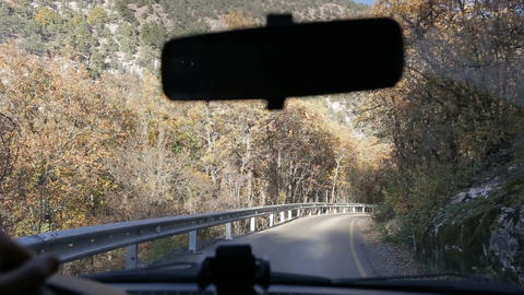 Driving on mountain road in Crimea. View from a car on mountains. Car front Live Action