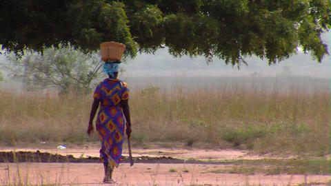 African woman walking with a machete Footage