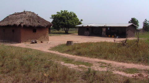 A building and a grassy hut in Africa Footage