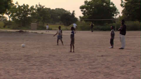 Kids playing soccer in Africa Footage