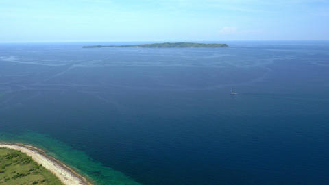 Aerial - Flight above shore. View at the island from distance Footage